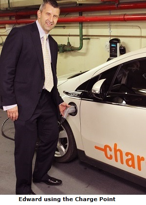 Edward using the Charge Point to recharge an electric car.